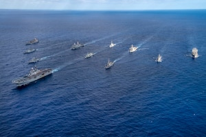 From left the Henry J. Kaiser-class underway replenishment oiler USNS Rappahannock (T-AO 204), and multinational steam in formation during Talisman Sabre (TS) 21.