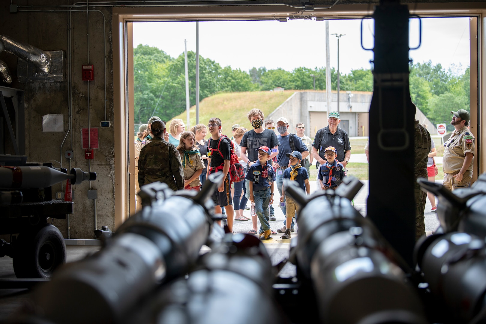 Children from a local scout group along with civilians look into a munitions bunker during a group tour of the Vermont Air National Guard base.