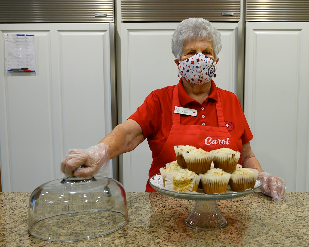 Carol McClure gets set to hand out some of her blueberry muffins July 16 in the Fisher House at Wright-Patterson Air Force Base. McClure was honored as the 2021 Air Force Fisher House Volunteer of the Year. (U.S. Air Force photo by R.J. Oriez)