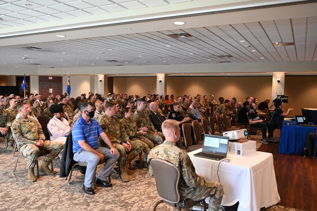 Airmen and civilian personnel attend the 88th Air Base Wing commander's quarterly all-call July 22 at the Wright-Patterson Club. The event was also broadcast virtually for others across base. (U.S. Air Force photo by R.J. Oriez)