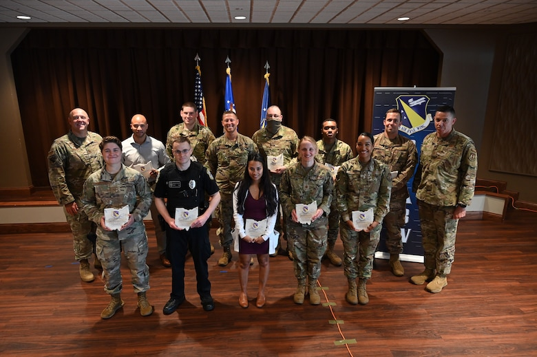 The 88th Air Base Wing's quarterly award winners are recognized by Col. Patrick Miller (far left), 88 ABW and installation commander, and Chief Master Sgt. Jason Shaffer (far right), 88 ABW command chief, during the commander's call July 22 at the Wright-Patterson Club. (U.S. Air Force photo by R.J. Oriez)