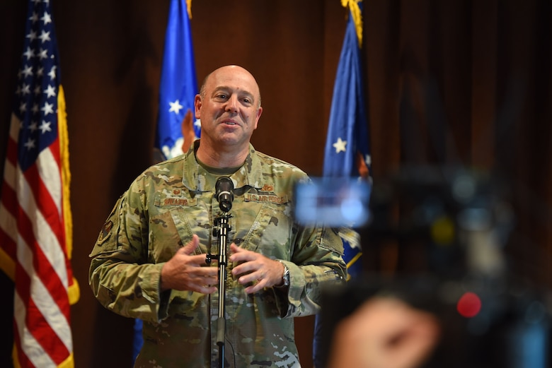 Col. Patrick Miller, 88th Air Base Wing and installation commander, conducts a quarterly commander's call July 22 at the Wright-Patterson Club. The hybrid event included a number of Airmen in attendance while many watched it streamed online. (U.S. Air Force photo by R.J. Oriez)