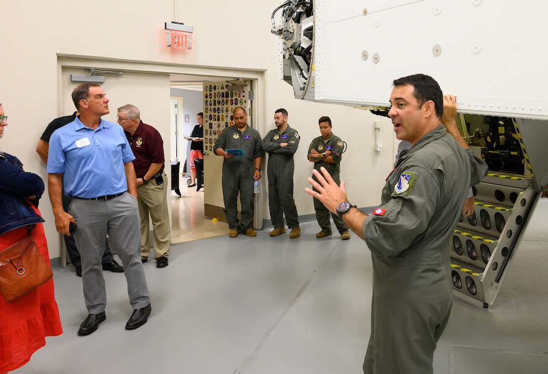 Tech. Sgt. Tony Longinotti, U.S. Air Force School of Aerospace Medicine's Accelerations Operations Section chief, shows Leadership Dayton program members the 711th Human Performance Wing's centrifuge July 14 at Wright-Patterson Air Force Base. Longinotti told the group how the centrifuge is used to both conduct research and train Airmen. (U.S. Air Force photo by R.J. Oriez)