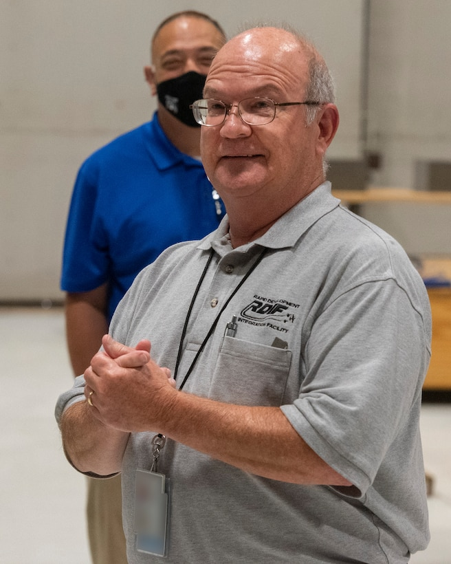 Alan Brookshire, Rapid Development Integration Facility technical director, talks to Leadership Dayton program members July 14 about the organization's mission to provide rapid engineering solutions for urgent warfighter needs. The group toured Wright-Patterson Air Force Base to learn about the installation's capabilities and its contributions to the community. (U.S. Air Force photo by R.J. Oriez)