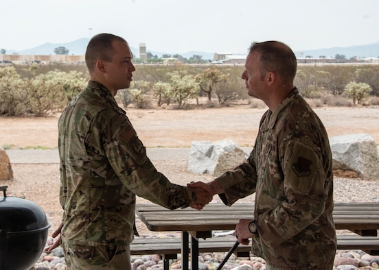 A photo of Airmen shaking hands.
