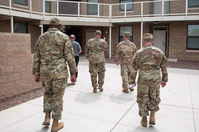 A photo of Airmen walking towards a building.