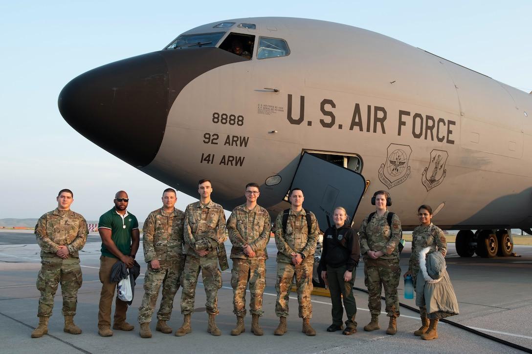 Airmen pose