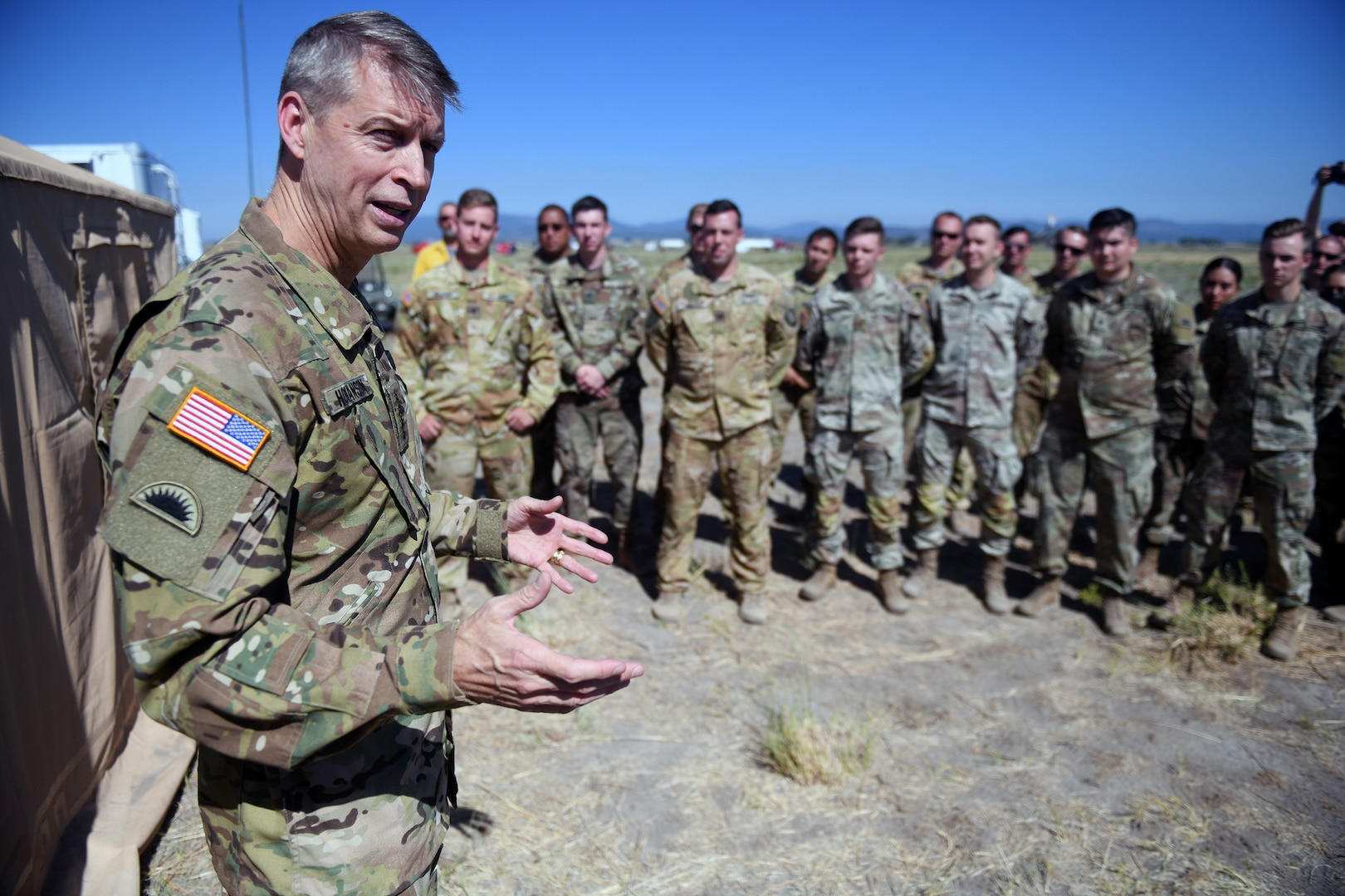 Army Gen. Daniel Hokanson, chief, National Guard Bureau, thanks National Guard members for their ongoing support to local, state and federal agencies fighting the Bootleg Fire, Lakeview, Oregon, July 22, 2021.