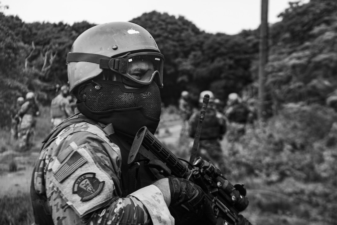 A U.S. Air Force Airman assigned to the 154th Fighter Wing, Hawaii Air National Guard participates in a combat readiness training scenario during Operation Pacific Iron 2021, July 20, 2021, at Andersen Air Force Base, Guam.