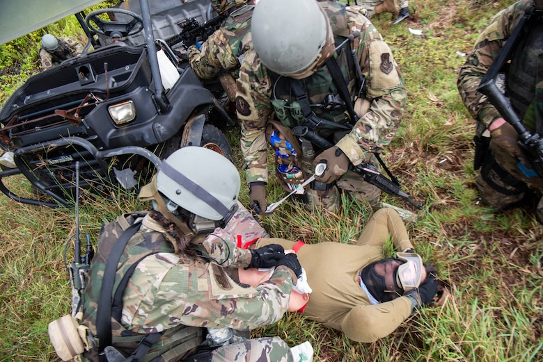U.S. Air Force Airmen assigned to the 154th Fighter Wing, Hawaii Air National Guard perform simulated emergency field medical procedures during a combat readiness training course during Operation Pacific Iron 2021, July 20, 2021, at Andersen Air Force Base, Guam.