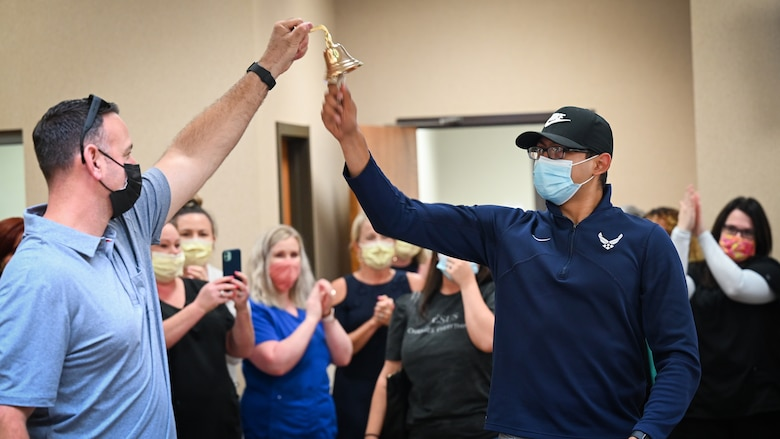 Senior Airman Eleazar Hernandez, 2nd Maintenance Squadron aerospace ground equipment journeyman, rings a bell after his final chemotherapy treatment at the CHRISTUS Health Shreveport-Bossier medical center, Louisiana, July 2, 2021. The bell signals the end of chemotherapy treatment and a warm tradition among cancer patients completing radiation treatments. (U.S. Air Force photo by Airman 1st Class Jonathan E. Ramos)