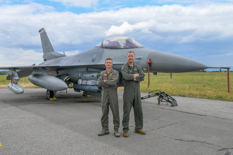 U.S. Air Force Capt. Justin Goar, 555th Fighter Squadron F-16 Fighting Falcon pilot, left, and Bulgarian air force Maj. Petar Milkov, L-39 Albatros instructor, pose for a photo during exercise Thracian Star 21 at Graf Ingatievo Air Base, Bulgaria, July 22, 2021. Thracian Star 21 is a multilateral training exercise with the Bulgarian air force that increases operational capacity, capability and interoperability with Bulgaria. (U.S. Air Force photo by Airman 1st Class Brooke Moeder)