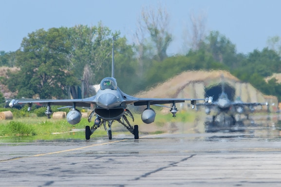 Two U.S. Air Force F-16 Fighting Falcons assigned to the 555th Fighter Squadron taxis on the flightline during Thracian Star 21 at Graf Ignatievo Air Base, Bulgaria, July 20, 2021. Eight F-16s assigned to the 555th FS participated in Thracian Star 21, a Bulgarian air force-led exercise aiming to enhance interoperability and the ability to rapidly deploy to remote locations. (U.S. Air Force photo by Airman 1st Class Brooke Moeder)