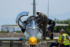 A Bulgarian air force pilot prepares to fly in an Aero L-39 Albatros at Graf Ignatievo Air Base, Bulgaria, July 13, 2021. Successful partnering activities such as Thracian Star 21, a Bulgarian air force-led exercise, result in progressive relationships and lead to tangible, mutual benefits during peacetime, contingencies and crisis, through actions such as regional security, access and coalition operations. (U.S. Air Force photo by Airman 1st Class Brooke Moeder)
