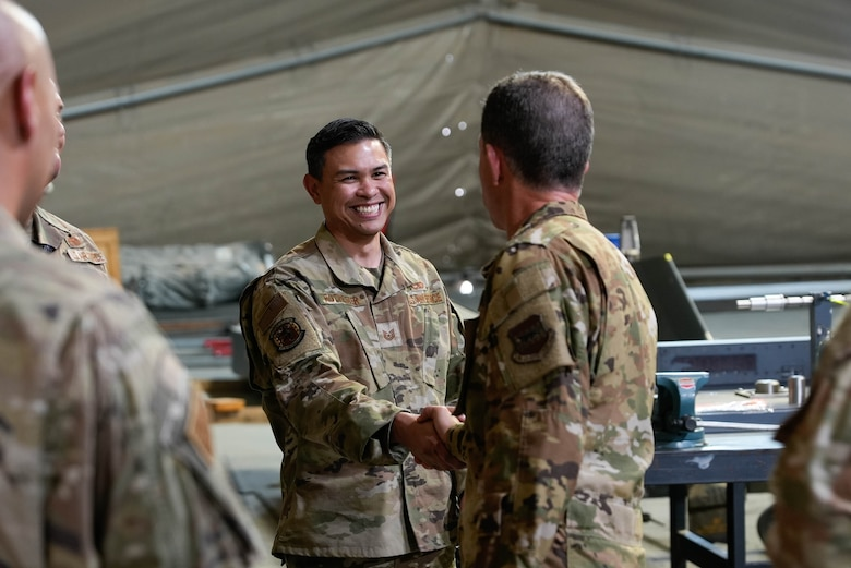 Two U.S. Airmen shake hands