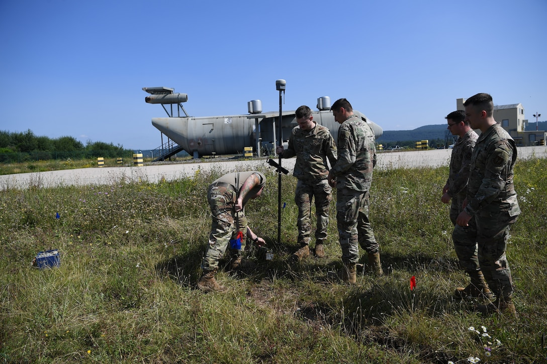 Airman mark the location of debris