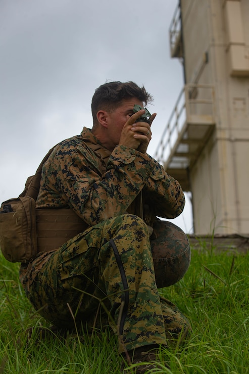 U.S. Marine Corps Lance Cpl. Sayediman Sadrhajsayedjavadi, a fire support Marine with 2d Battalion, 10th Marine Regiment, 2d Marine Division (MARDIV), locates grid coordinates for fire missions as part of a Marine Corps Combat Readiness Evaluation (MCCRE) for 2d Battalion, 6th Marine Regiment, 2d MARDIV, on Camp Lejeune, N.C., July 20, 2021. A MCCRE is an exercise designed to formally evaluate a unit's combat readiness and if successful, the unit will be deemed ready for global employment. (U.S. Marine Corps photo by Lance Cpl. Reine Whitaker)
