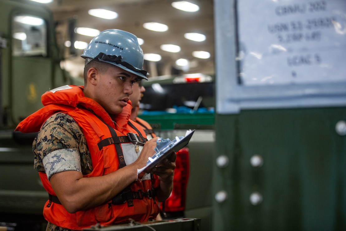 Marines and Sailors with the II Marine Expeditionary Force Maritime DSCA Task Force, commanded by Combat Logistics Battalion 22, and Sailors aboard the USS Arlington conducted a destructive weather mission rehearsal loading exercise to prepare and rehearse for a future DSCA mission during the 2021 hurricane season.