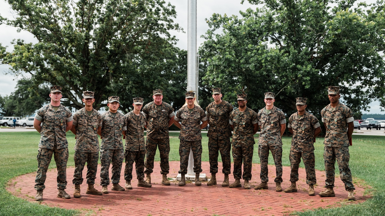 U.S. Marines with Headquarters Battalion (HQBN) and 2d Combat Engineer Battalion (CEB) pose for a photo with the 2d Marine Division commanding staff at Camp Lejeune, N.C., July 21, 2021. Marines with HQBN and 2d CEB were awarded the Navy and Marine Corps Achievement Medal for their superior performance for their efforts during the five-day High Frequency Radio competition. (U.S. Marine Corps photo by Cpl. Patrick King)