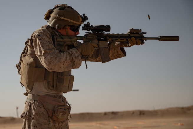 A U.S. Marine, with 2nd Battalion, 1st Marine Regiment, assigned to Special Purpose Marine Air-Ground Task Force – Crisis Response – Central Command (SPMAGTF-CR-CC), fires an M4 service rifle at a target during a Combat Marksmanship Program (CMP) range in the Kingdom of Saudi Arabia, June 11, 2021. The CMP range allows Marines to maintain rifle proficiency by engaging targets at various distances. The SPMAGTF-CR-CC is a crisis response force, prepared to deploy a variety of capabilities across the region. (U.S. Marine Corps photo by Lance Cpl. Willow Marshall)