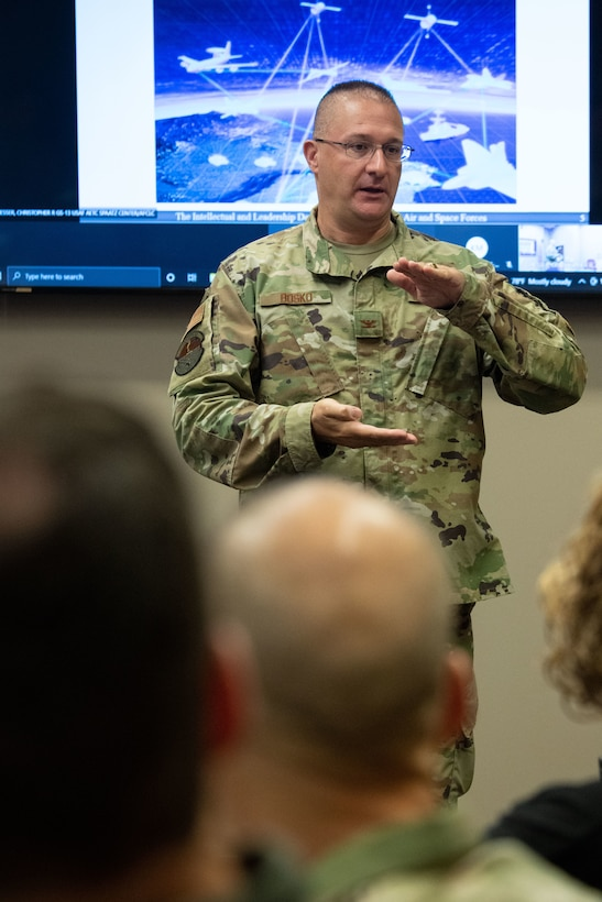 Col. David Bosko, commandant, Air Force Cyber College, leads a discussion with Air Force and Space Force Language Enabled Airmen Program scholars attending the Cyber Language Intensive Training Event course, July 22, 2021, Maxwell Air Force Base, Ala. Cyber LITE is a strategic competition course co-sponsored by the Air Force Culture and Language Center and Air Force Cyber College for advanced language proficiency LEAP scholars who have career-related ties to cyber operations or an academic background in cyber studies.