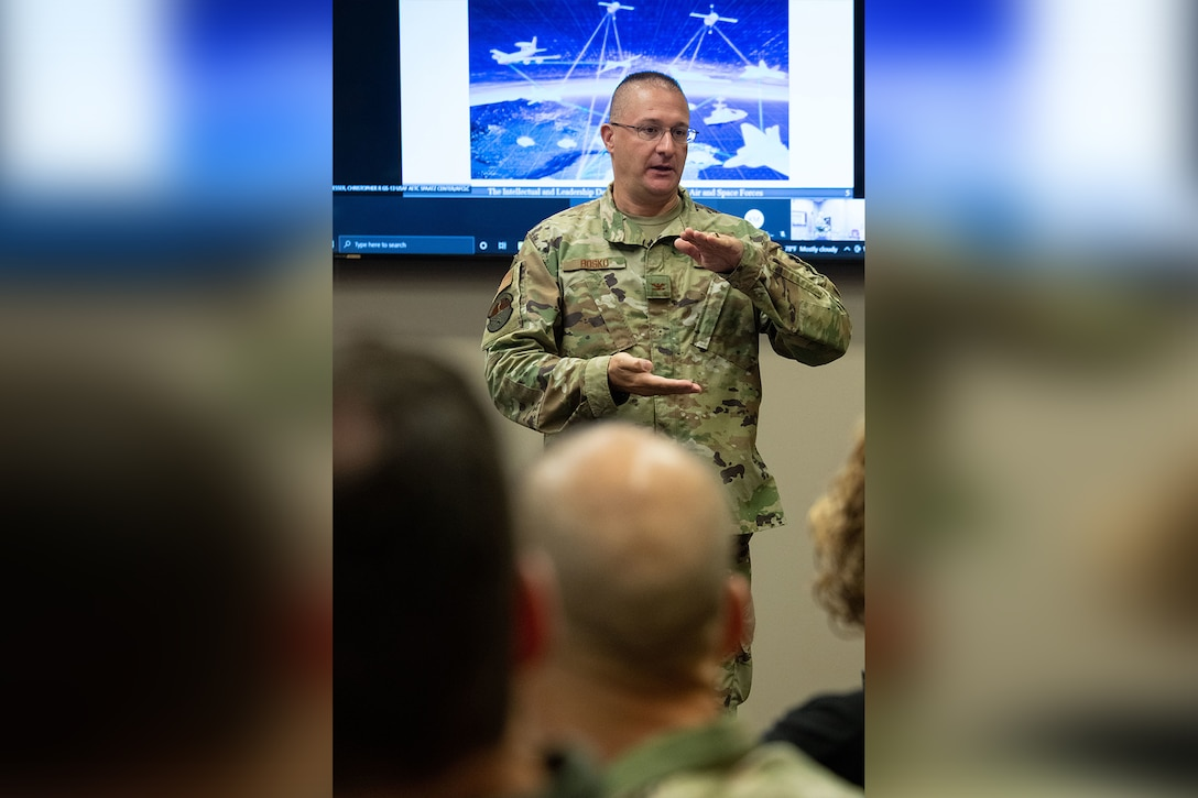 Col. David Bosko, commandant, Air Force Cyber College, leads a discussion with Air Force and Space Force Language Enabled Airmen Program scholars attending the Cyber Language Intensive Training Event course, July 22, 2021, Maxwell Air Force Base, Ala. Cyber LITE is a strategic competition course co-sponsored by the Air Force Culture and Language Center and Air Force Cyber College for advanced language proficiency LEAP scholars who have career-related ties to cyber operations or an academic background in cyber studies. (U.S. Air Force photo by Melanie Rodgers Cox)