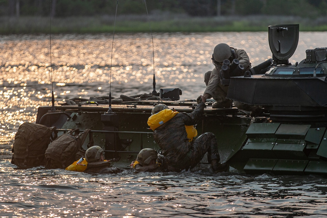U.S. Marines with 1st Battalion, 2d Marine Regiment, (1/2) 2d Marine Division board an assault amphibious vehicle during a mechanized amphibious egress exercise on Camp Lejeune, N.C., July 22, 2021. The exercise improves how 1/2 integrates with 2d Assault Amphibious Battalion and prepares the unit for future conflict by strengthening its naval expeditionary capabilities. (U.S. Marine Corps photo by Lance Cpl. Brian Bolin Jr.)