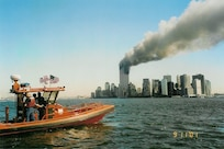 A Coast Guard RHIB off Manhattan on the morning of 11 September 2001 (not a USCG photograph). Photo was taken by Chan Irwin and was provided courtesy of Mike Harmon.