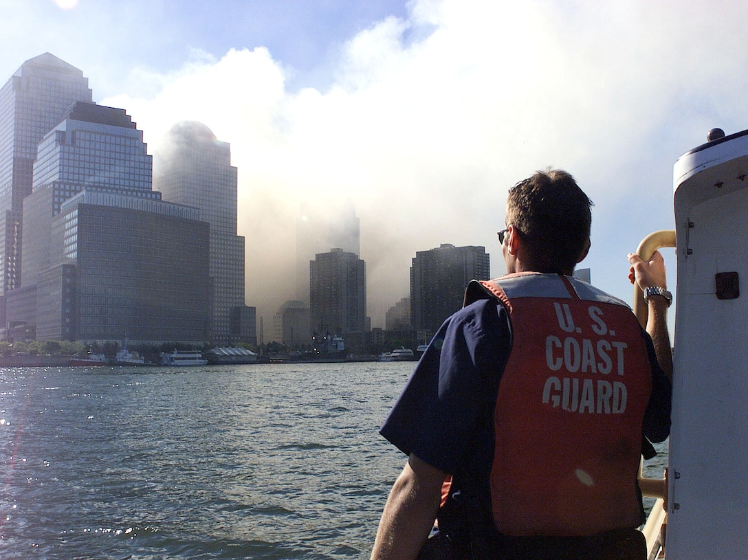 Coast Guard crewmembers patrol the harbor after the collapse of the World Trade Center.  Terrorist hijacked four commercial jets and then crashed them into the World Trade Center in New York, the Pentagon and the Pennsylvania countryside.  USCG photo by PA2 Tom Sperduto