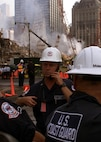 embers of the U.S. Coast Guard Atlantic Strike Team, from Fort Dix, N.J., continue to monitor air quality and coordinate equipment and personnel wash-downs amid the rubble of the Sept., 11 World Trade Center attack in New York City.