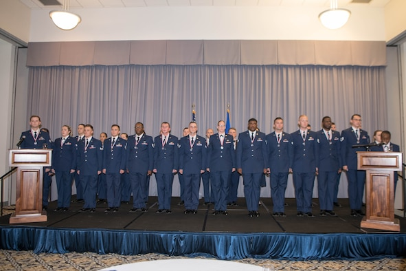 Graduates of the Staff Sgt. Julio Alonso Airman Leadership School, Class 21-F, recite the Airman's Creed during their graduation ceremony held at The Landings on Dover Air Force Base, Delaware, July 22, 2021. Twenty-nine Airmen graduated at the first post-COVID-19 dinner and graduation ceremony. (U.S. Air Force photo by Mauricio Campino)