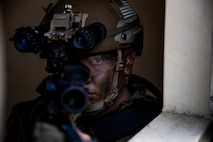 A U.S. Marine, assigned to 1st Battalion, 1st Marine Regiment, 1st Marine Division, looks through the sights of an M4 carbine on May 25, 2021 at Camp Pendleton, California. Marines with the 11th Marine Expeditionary Unit conducted an amphibious assault as one of the culminating events for pre-deployment training.