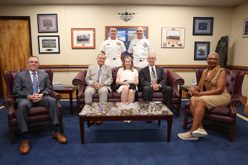 """ear Adm. Pete Garvin, commander, Naval Education and Training Command (NETC), back left, and Force Master Chief Matthew Harris, back right, meet with former NETC leaders to celebrate NETC's 50th anniversary at Naval Air Station Pensacola.  Seated from left to right are retired Force Master Chief Greg Pratt; retired Master Chief Petty Officer of the Navy Jim Herdt; Ms. Nancy Fetterman, who served alongside her late husband, Vice Adm. John """"Jack"""" Fetterman; retired Rear Adm. Donald Quinn; and retired Fleet Master Chief April Beldo-Lilley."""