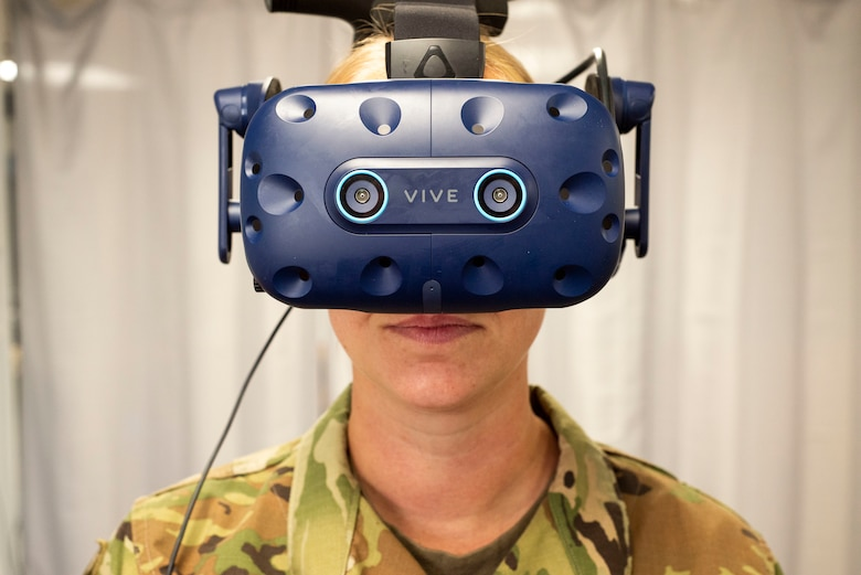 Air Force Staff Sgt. Renee Scherf, Detachment 23 curriculum engineer, MC-130H subject matter expert, dons virtual reality goggles. Members of Detachment 23's Tech Training Transformation are part of Air Education and Training Command and responsible for re-engineering tech training. Their cutting-edge program utilizes virtual reality training systems and artificial intelligence, among other modalities, to transform the Airmen development process. (Photo by Air Force Staff Sgt. Keith James)