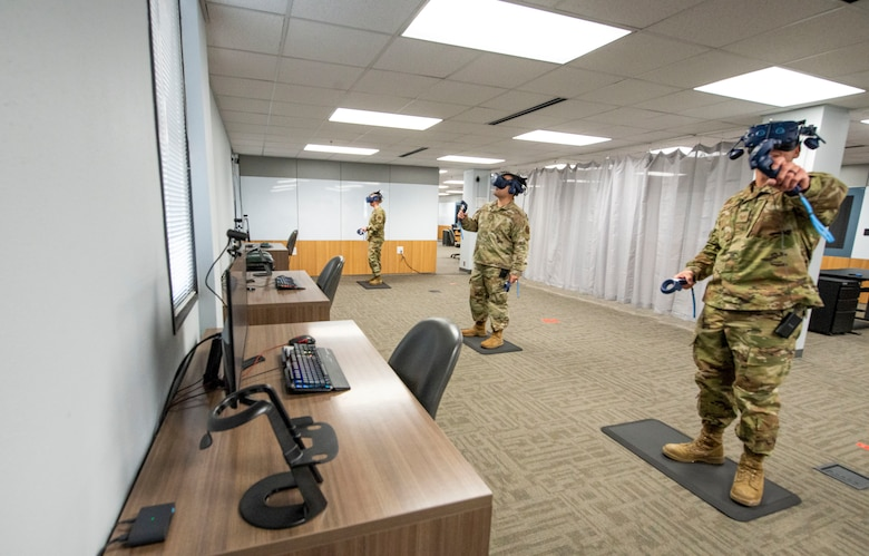 Air Force Tech Sgt. Casey Michalski (left), Staff Sgt. Kevin Lassen, and Staff Sgt. Renee Scherf, Detachment 23 curriculum engineers, test virtual reality training systems. Members of Detachment 23's Tech Training Transformation are part of Air Education and Training Command and responsible for re-engineering tech training. Their cutting-edge program utilizes virtual reality training systems and artificial intelligence, among other modalities, to transform the Airmen development process. (Photo by Air Force Staff Sgt Keith James)