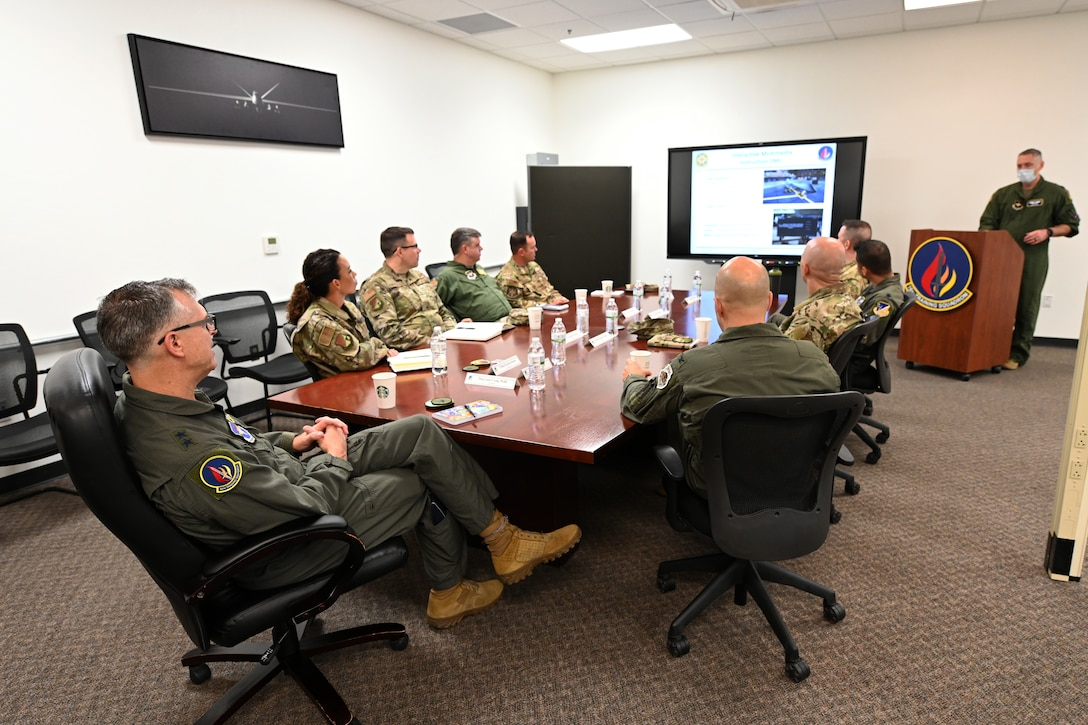 Maj. Gen. Craig D. Wills, 19th Air Force commander, listens to a 16th Training Squadron mission brief July 20, 2021, on Holloman Air Force Base, N.M. The command team held three all calls and discussed the future of the MQ-9 Reaper enterprise. (U.S. Air Force photo by Staff Sgt. Christopher S. Sparks)