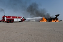 Chief Master Sgt. Kristina Rogers, 19th Air Force command chief, extinguishes a simulated aircraft fire, July 21, 2021, on Holloman Air Force Base, N.M. During the visit, the command team visited locations including the 16th Training Squadron, Holloman Airman Leadership School and the 49th Civil Engineer Squadron. (U.S. Air Force photo by Staff Sgt. Christopher S. Sparks)