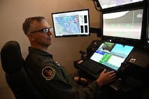 Maj. Gen. Craig D. Wills, 19th Air Force commander, flies an MQ-9 Reaper simulator, July 20, 2021, on Holloman Air Force Base, N.M. The command team held three all-calls with the wing, and spoke on the importance of training, readiness and how our Airmen give the U.S. Air Force a competitive edge in our fight against U.S. adversaries. (U.S. Air Force photo by Staff Sgt. Christopher S. Sparks)