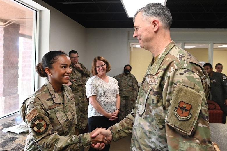 Maj. Gen. Craig D. Wills, 19th Air Force commander, coins a 49th Wing dorm resident advisor July 20, 2021, on Holloman Air Force Base, N.M. The Dorm RA council is the first of its kind in the Air Education Training Command. (U.S. Air Force photo by Staff Sgt. Christopher S. Sparks)