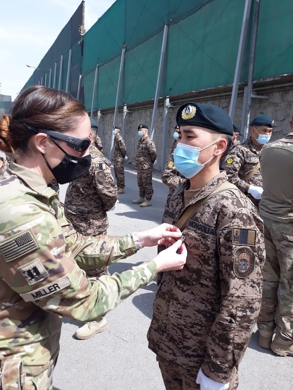 Alaska Army National Guard Capt. Jessica Miller and Sgt. 1st Class Juan Restrepo spend time with their Mongolian counterparts during the last rotation of the Mongolian Expeditionary Task Force liaison program in New Kabul Compound, Afghanistan, December 2020 - July 2021. This program started in 2003 shortly after the country was selected for Alaska's state partnership program, and finally came to an end in 2021 when the camp was signed over to the Afghan Army, the METF returned to Mongolia, and the Alaska National Guardsmen returned to Alaska. (Courtesy photo)