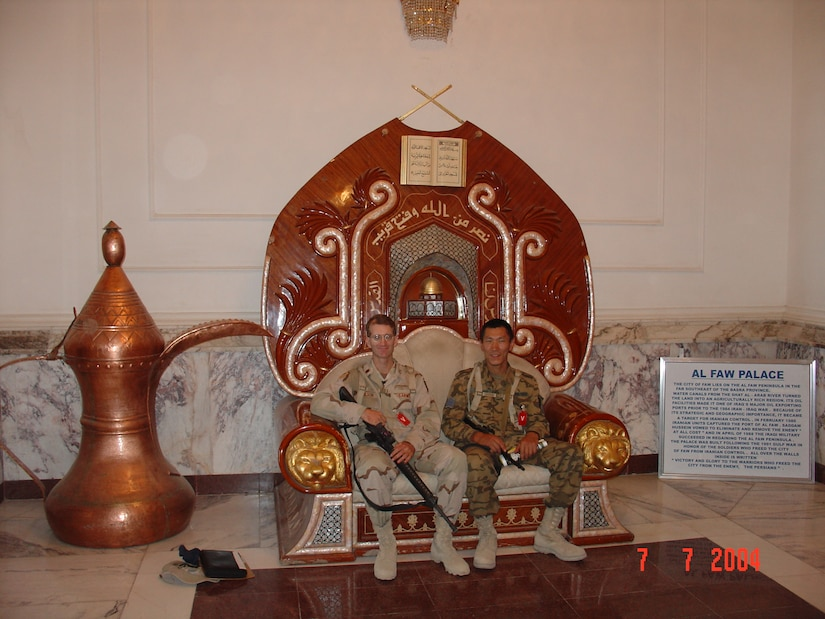 Lt. Col. Steve Wilson poses for a photo with one of his Mongolian counterparts in Iraq, July 7, 2004. Wilson was the first liaison to accompany the Mongolian Armed Forces on a deployment during the Global War on Terrorism as part of the state partnership program. The SPP is a program that links a state's National Guard with the armed forces or equivalent of a partner country in a cooperative, mutually beneficial relationship.  (Courtesy photo)