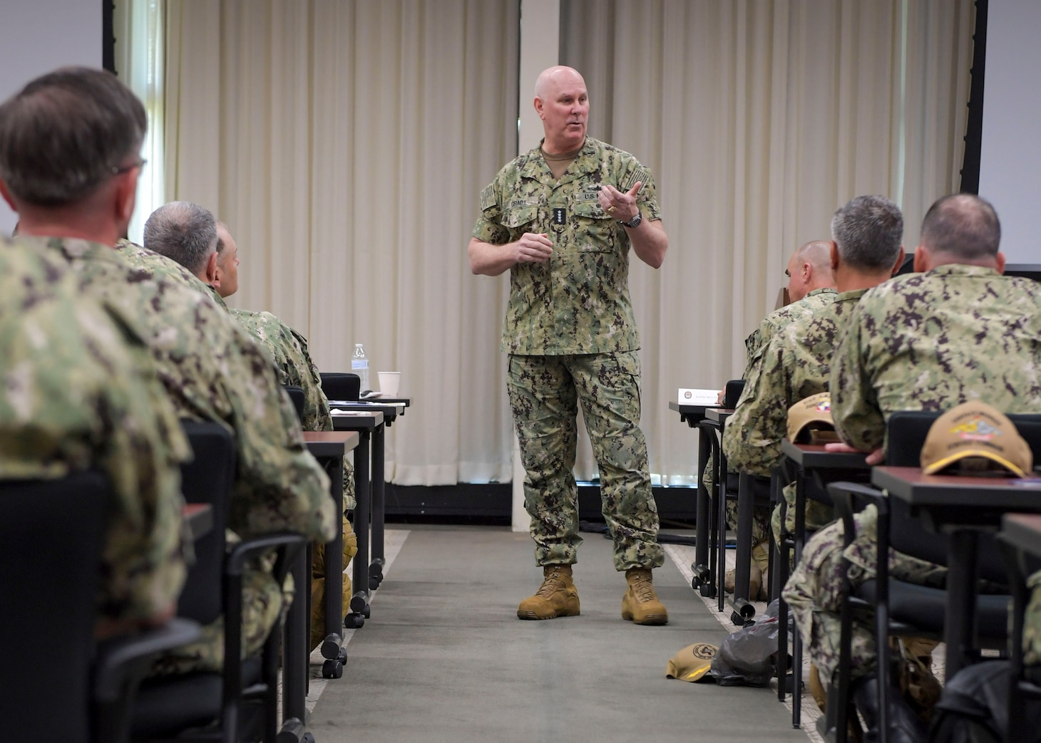"""VIRGINIA BEACH, Va. (July 23, 2021) Adm. Christopher W. Grady, commander, U.S. Fleet Forces Command, and the Navy's """"Old Salt,"""" delivers remarks at the annual Surface Force Atlantic (SURFLANT) two-day leadership training symposium at Drexler Manor Conference Center on Joint Expeditionary Base Little Creek-Fort Story, July 23. The event emphasized SURFLANT's top priority, which is to provide combat-ready ships and battle-minded crews that are prepared to fight and win operations in a strategic competition. (U.S. Navy photo by Mass Communication Specialist 1st Class Jacob Milham/Released)"""