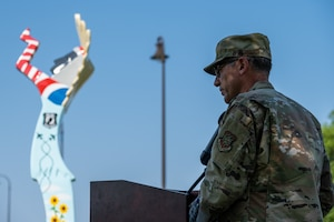 Col. Nate Vogel, 22nd Air Refueling Wing commander, gives a speech at the unveiling of the Keeper of the Plains replica donated to the base July 23, 2021, at McConnell Air Force Base, Kansas. The ten-foot-tall Keeper was donated by the Friends of McConnell organization and designed by Vincent Fredericksen, 22nd Civil Engineer Squadron base architect, and Staff Sgt. Trevor Bjelke, former 22nd Communications Squadron network infrastructure technician. (U.S. Air Force photo by Senior Airman Skyler Combs)