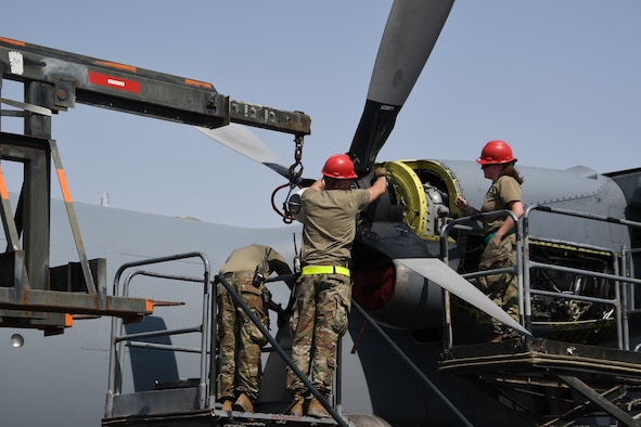 Members deployed from Maxwell Air Force Base, Alabama, and assigned to the 386th Expeditionary Aircraft Maintenance Squadron change a propeller on a C-130 Hercules. The EAMXS works 24-hour operations year-round to keep the C-130 Hercules' in flight to accomplish the mission of fight to win today and to provide warfighter support in the area of responsibility. (Courtesy Photo)