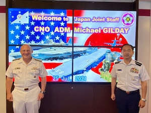 Chief of Naval Operations (CNO) Adm. Mike Gilday stands for a photo with Japan Chief of Staff of the Joint Staff Gen. Koji Yamazaki.