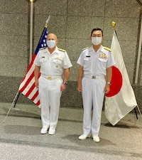 Chief of Naval Operations (CNO) Adm. Mike Gilday stands for a photo with Chief of the Maritime Staff Adm. Hiroshi Yamamura.
