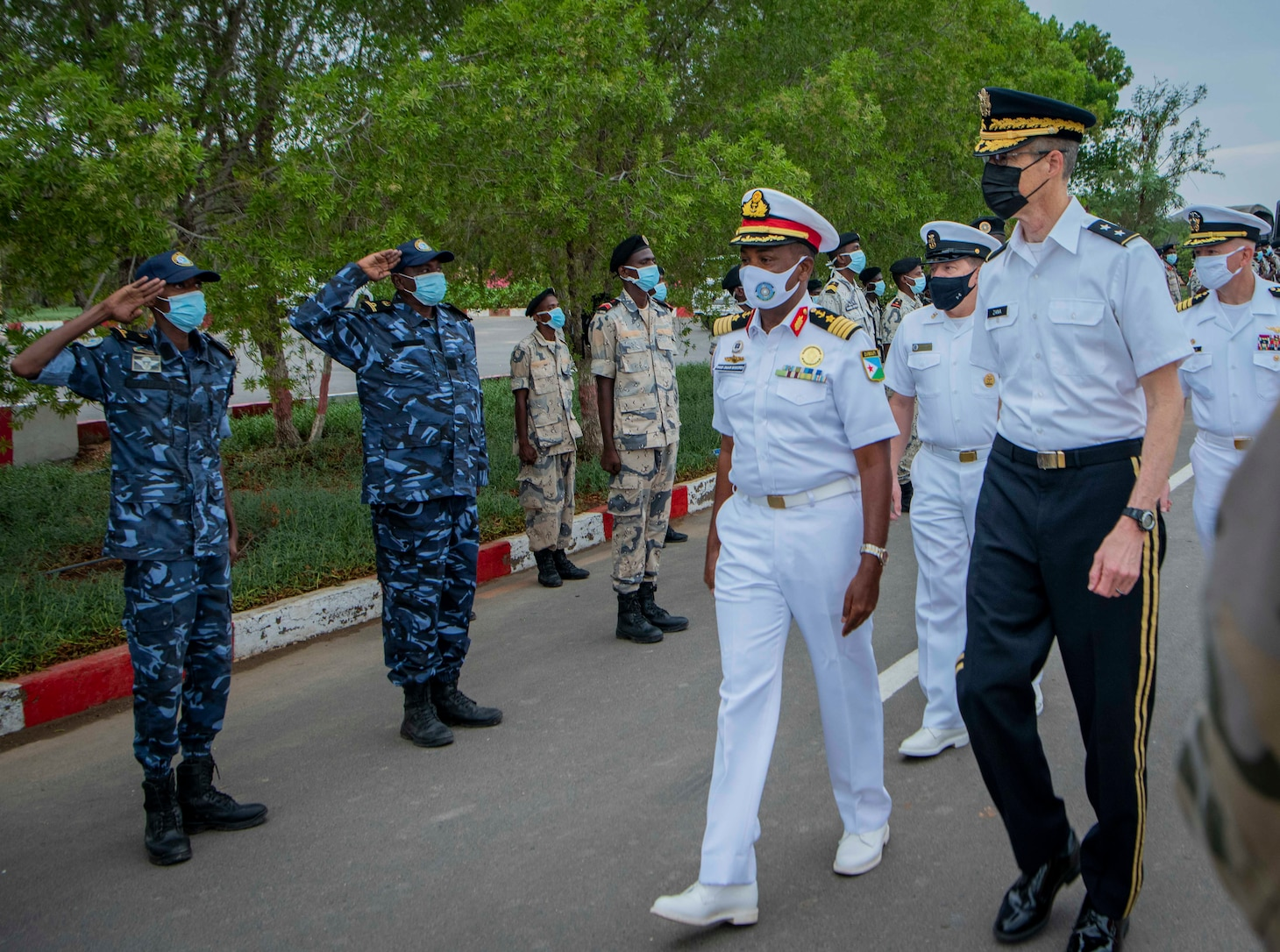 (July 25, 2021) Col. Ahmed Daher Djama, Djiboutian navy, center, walks with Gen. William Zana, Combined Joint Task Force-Horn of Africa commanding general, held at the Doraleh Coast Guard training center, in Djibouti, Djibouti, July 25, 2021, after the opening ceremony of exercise Cutlass Express 2021. Cutlass Express is designed to improve regional cooperation, maritime domain awareness and information sharing practices to increase capabilities between the U.S., East African and Western Indian Ocean nations to counter illicit maritime activity.