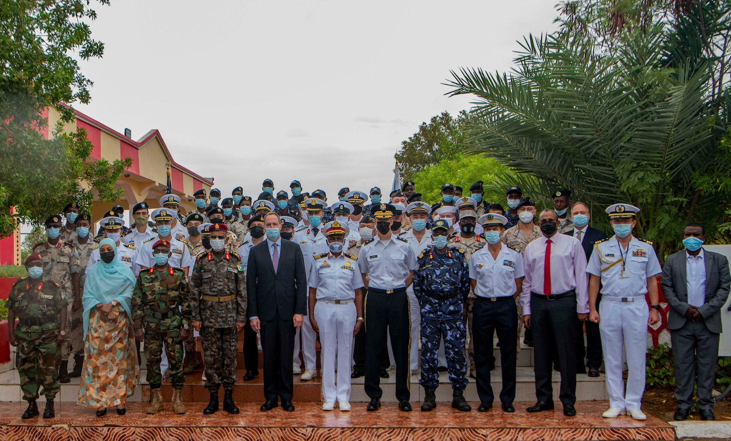 (July 25, 2021) Djiboutian and joint partner leadership pose for a group photo after the opening ceremony of exercise Cutlass Express 2021 held at the Doraleh Coast Guard training center in Djibouti, Djibouti, July 25, 2021. Cutlass Express is designed to improve regional cooperation, maritime domain awareness and information sharing practices to increase capabilities between the U.S., East African and Western Indian Ocean nations to counter illicit maritime activity.