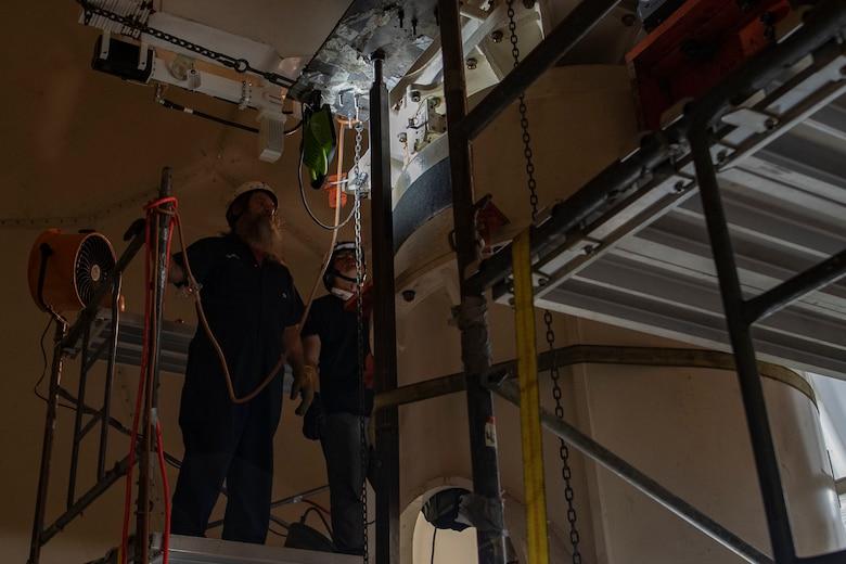 Contractors work on weather satellite