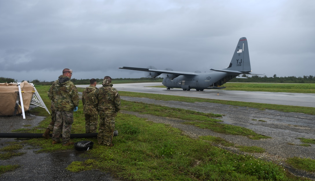 U.S. Air Force Airmen prepare to offload fuel from a C-130J Super Hercules July 21, 2021, at Tinian International Airport, Tinian, during Pacific Iron 2021. Pacific Iron 2021 is a Pacific Air Forces dynamic force employment operation to project forces into United States Indo-Pacific Command's area of responsibility in support of a more lethal, adaptive, and resilient force.